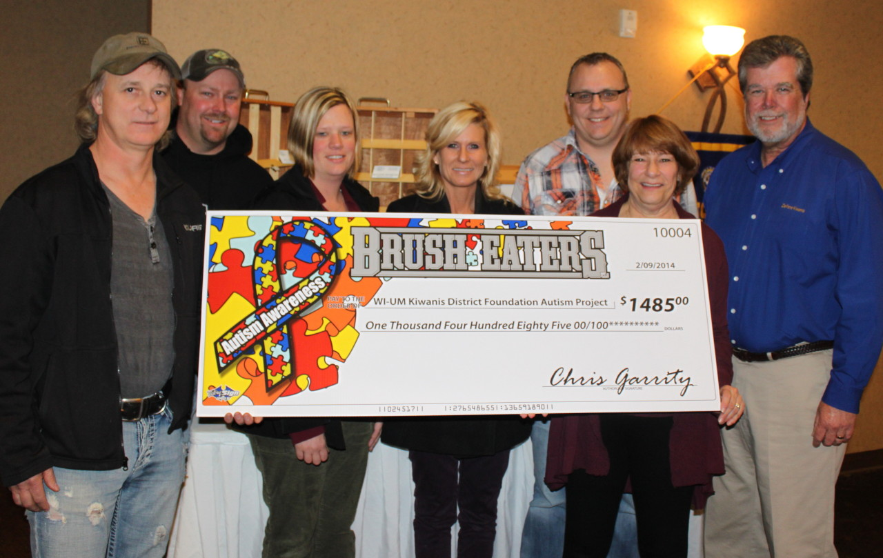 Brush Eaters LLC present Betsy Ingersoll with a very large check.