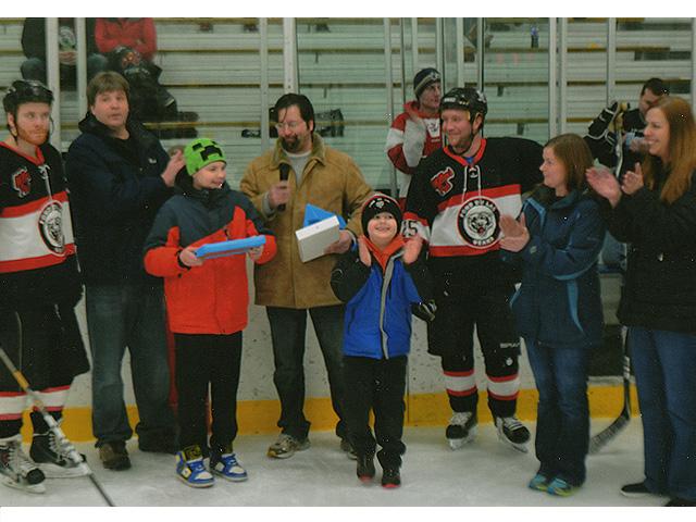 Benjamin Zimmerman receives iPad at Fondy Bears Hockey Night