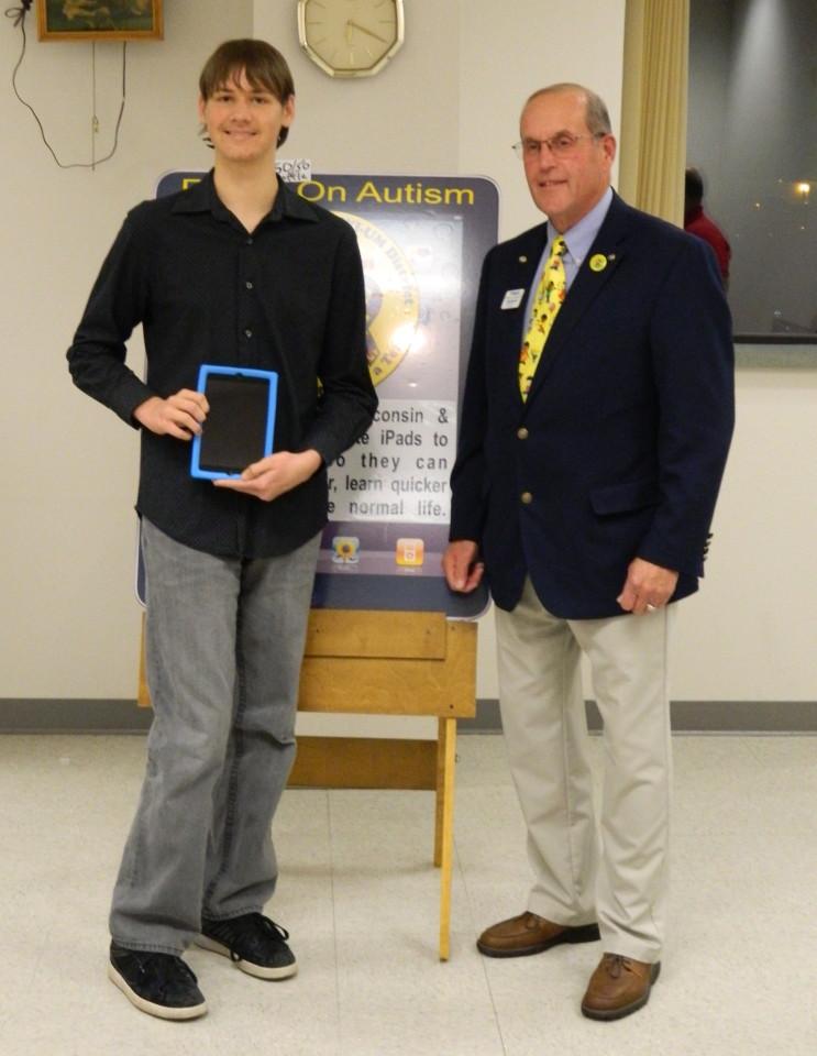 iPad recipient Logan Schonasky with Immediate Past Governor Lynn Messer