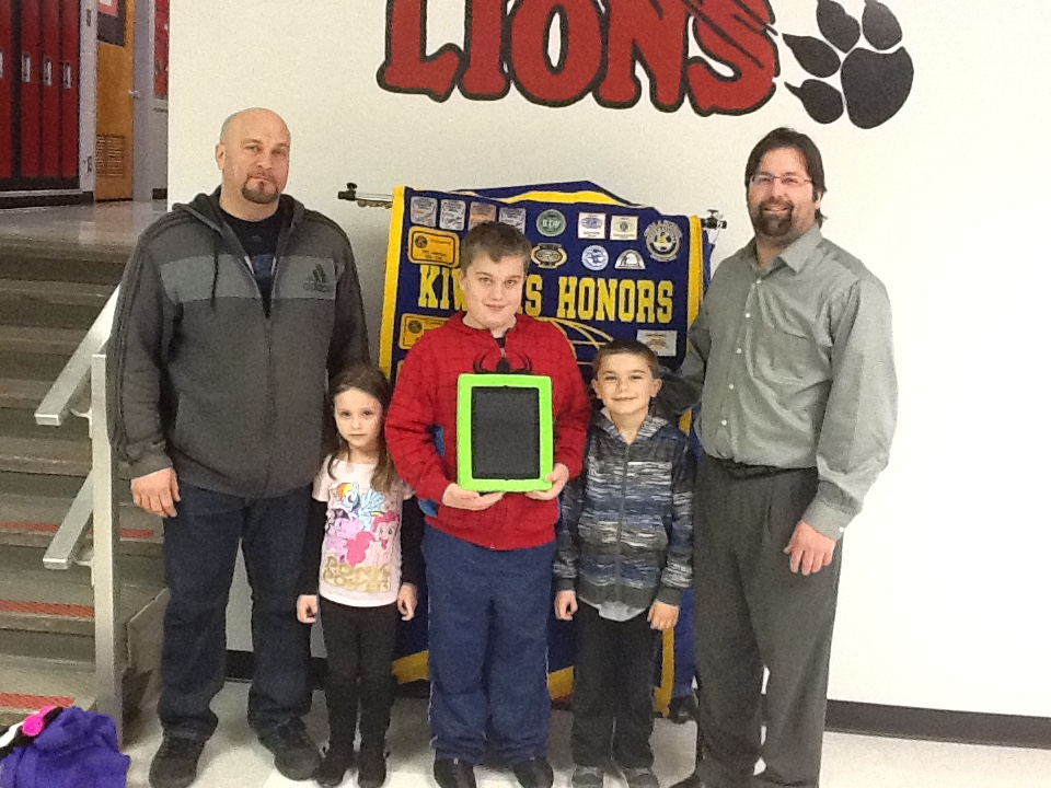 Cayden Jones receives iPad from Fond du Lac Lakeside Evening Kiwanis.